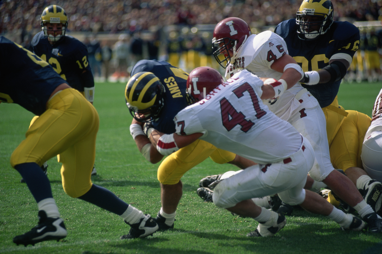 NCAA College football player being tackled during a game