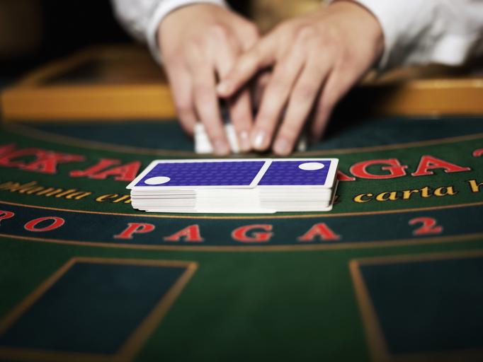 Shuffling playing cards on a blackjack gambling table