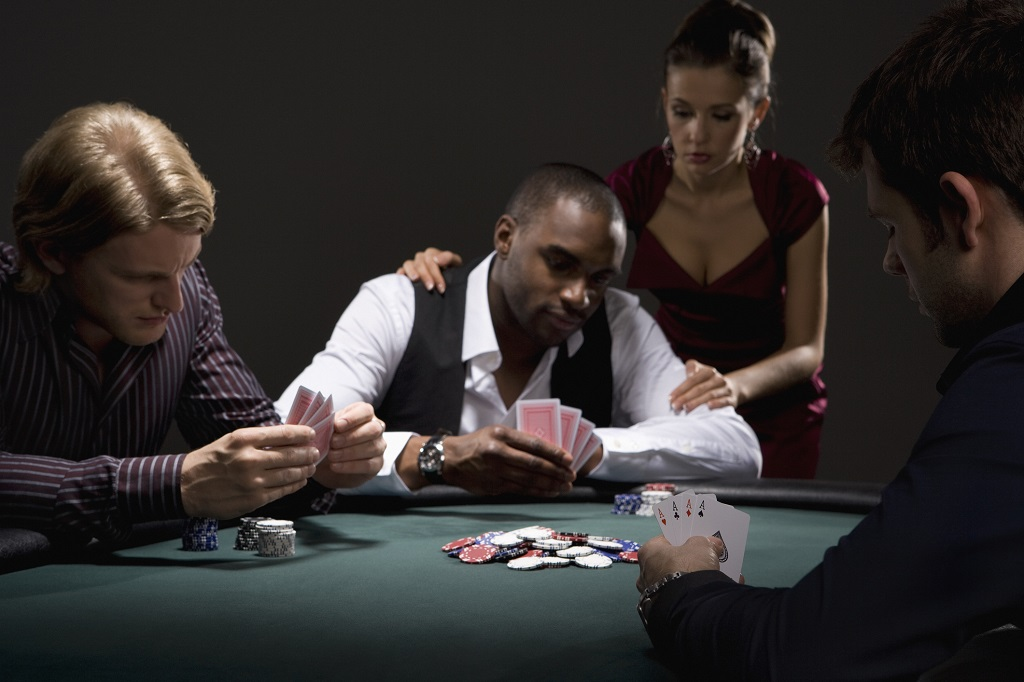 Three people playing a poker game