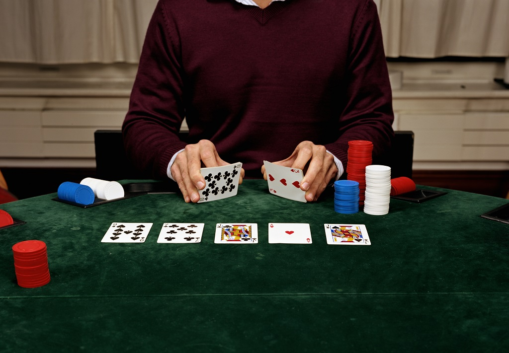 Poker dealer during a poker game