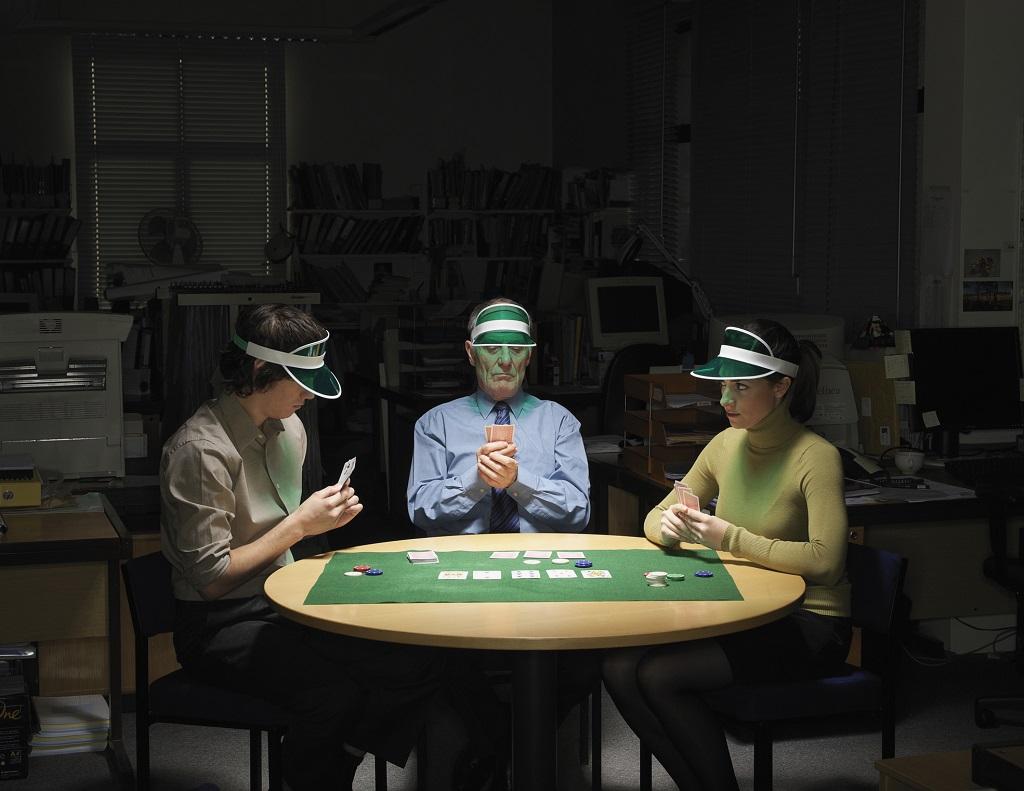 Three people playing poker