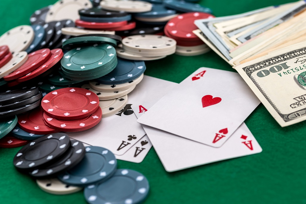 Poker chips, cards & cash on a poker table