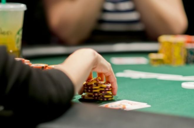 A poker player handling his chips during a game