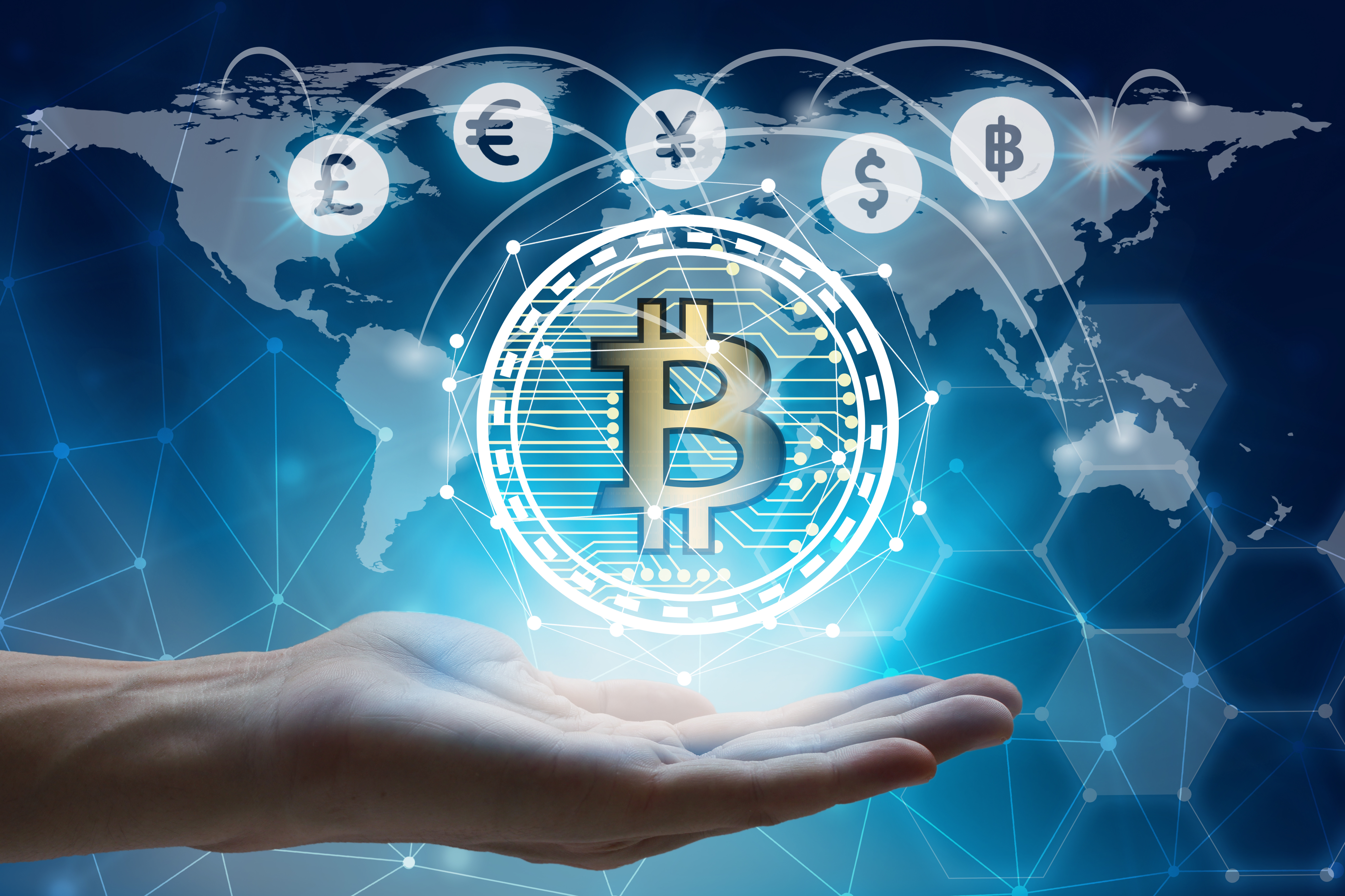 Hand holding bitcoin cryptocurrency with global background