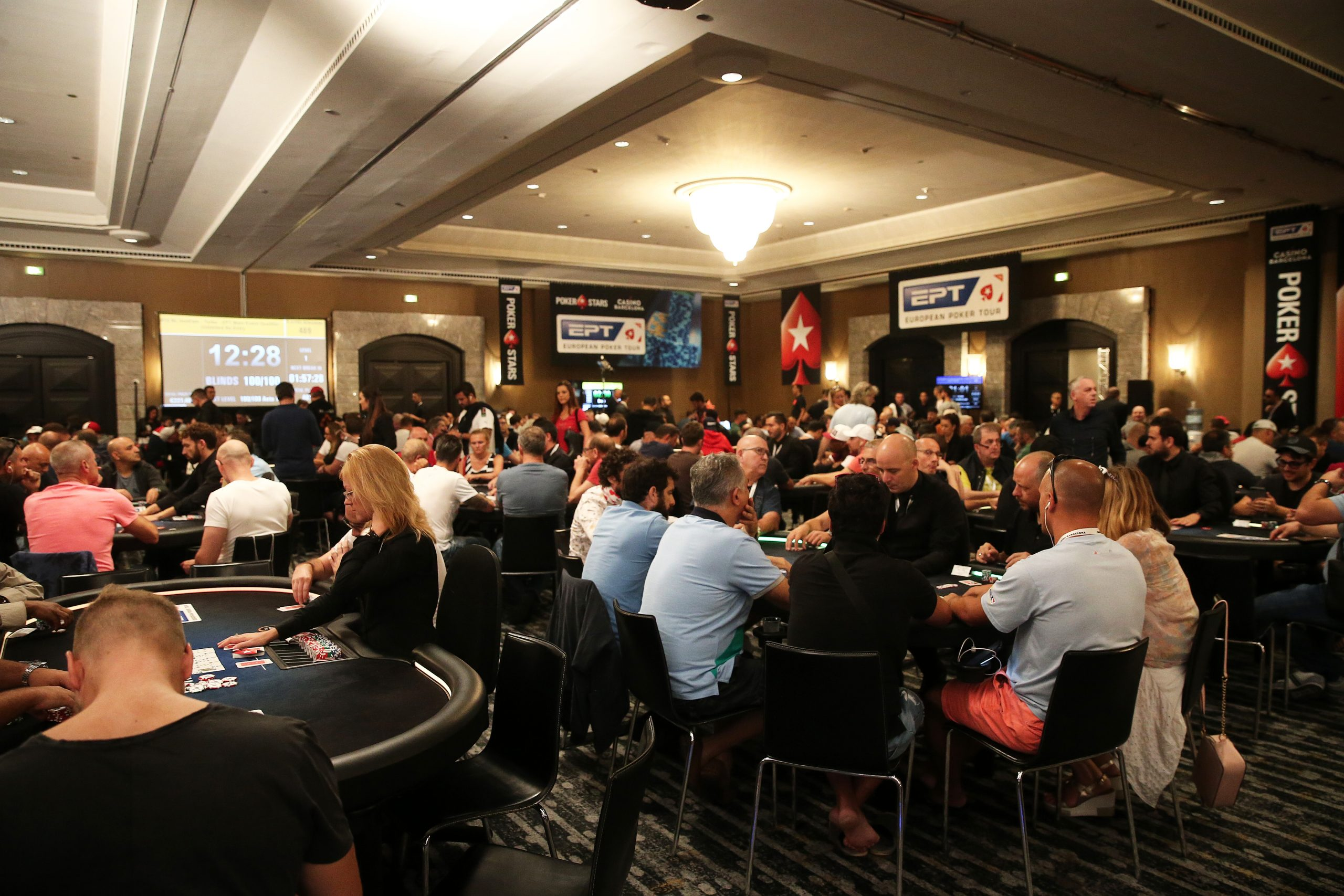 Poker players playing at a PokerStars Tournament Series