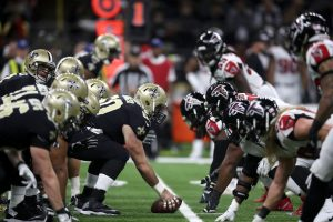 The New Orleans Saints and Atlanta Falcons prepare to take a snap