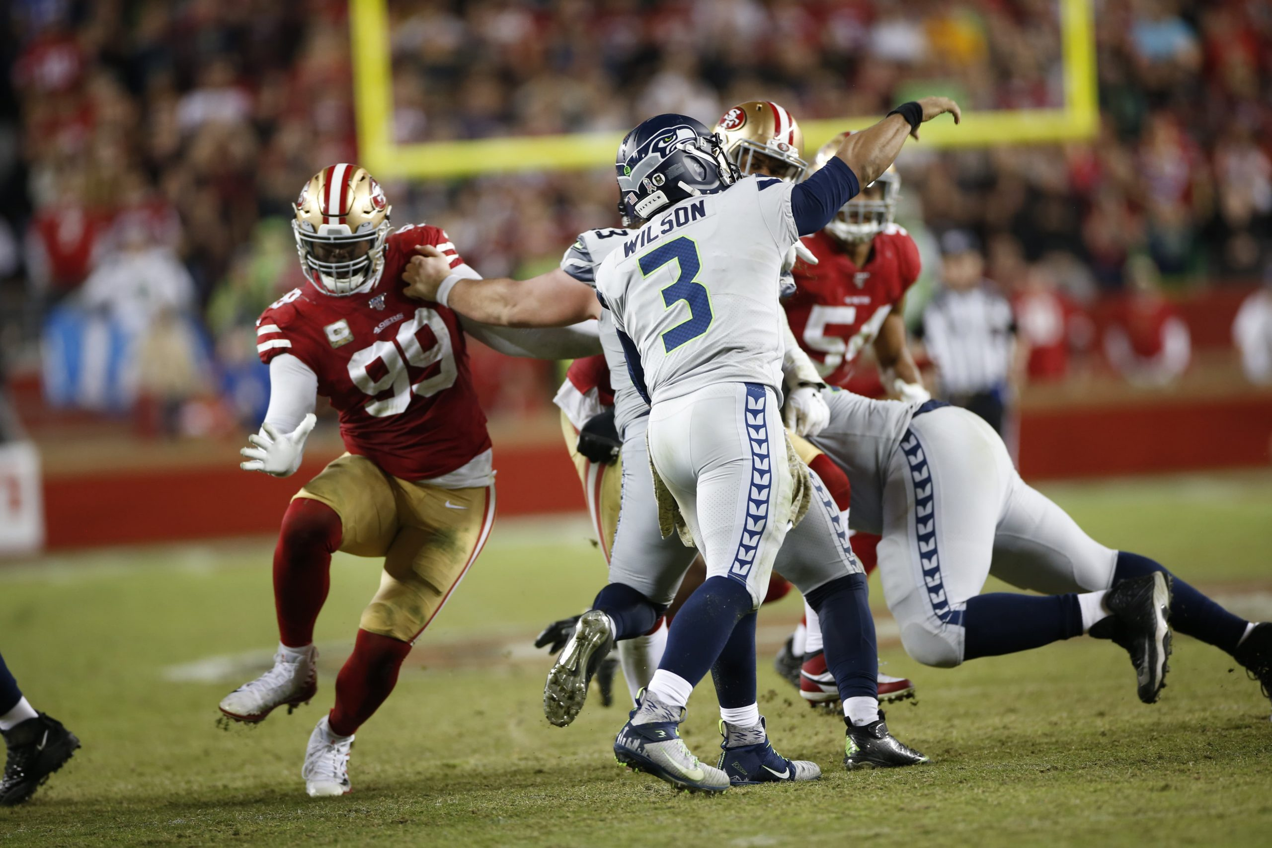 Seattle Seahawks quarterback Russell Wilson throwing a pass against the San Francisco 49ers