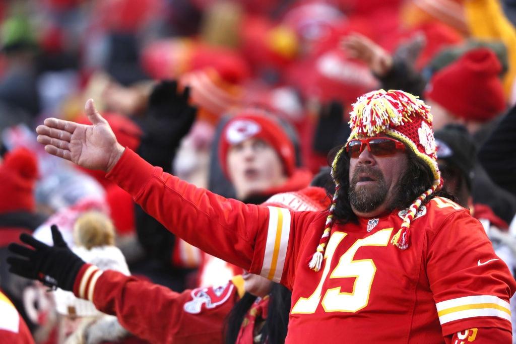 Kansas City Chiefs fan arrowhead stadium pointing towards a first down