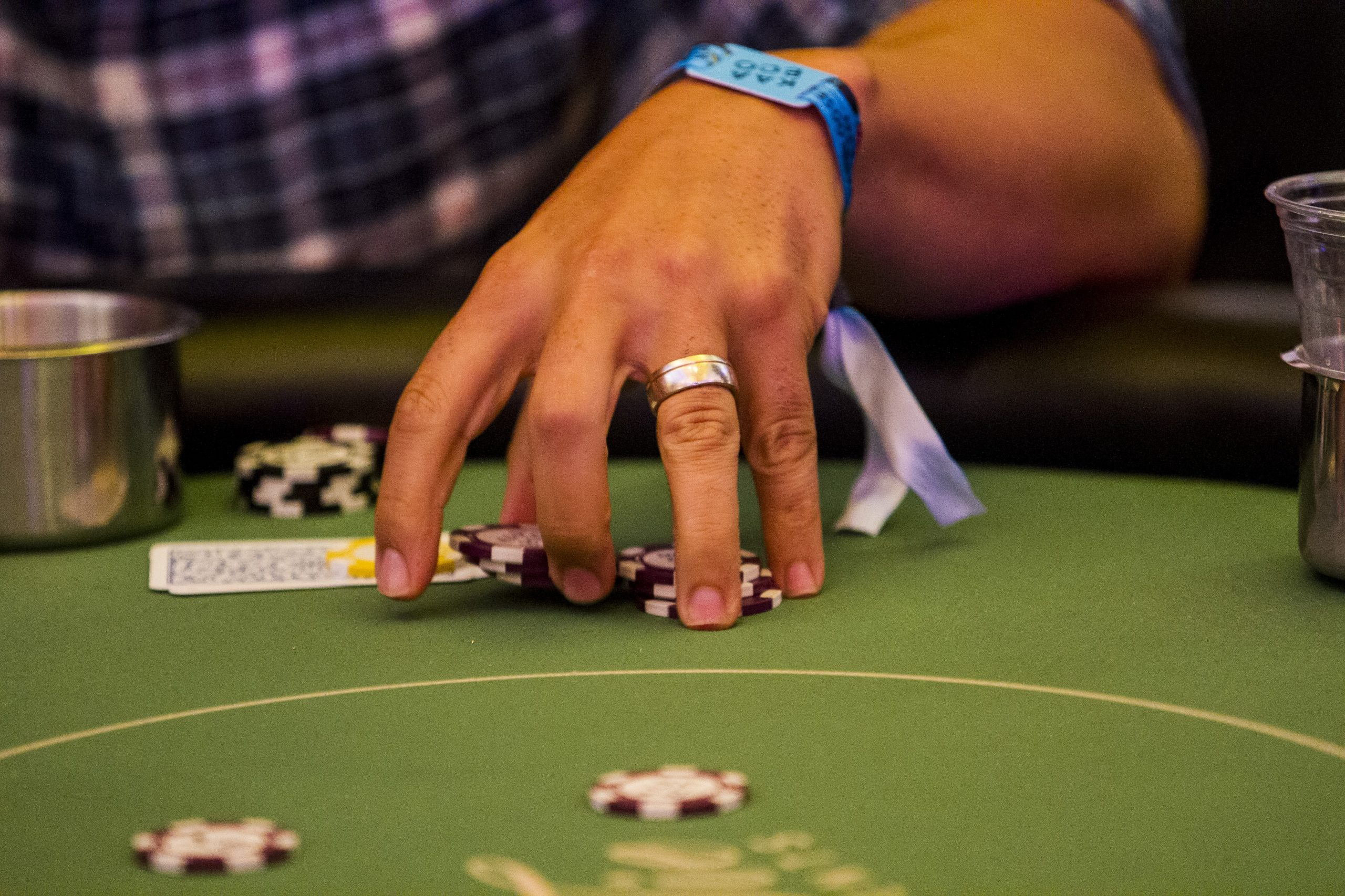 player pushing chips into the center of the table during WSOP event
