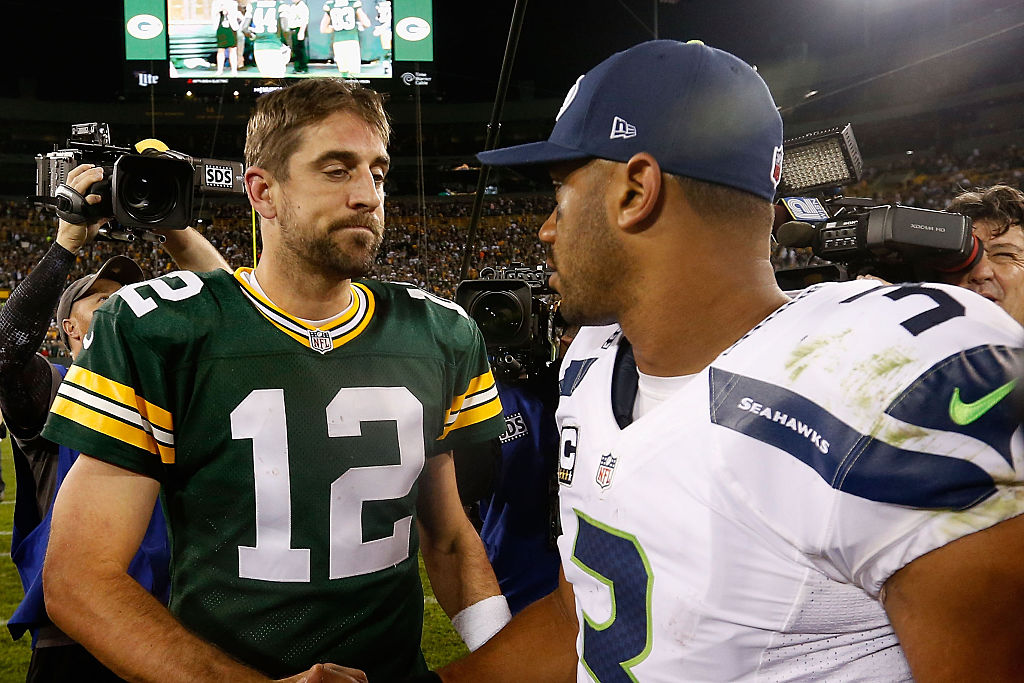Green Bay Packers QB Aaron Rodgers and Seattle Seahawks QB Russell Wilson shaking hands