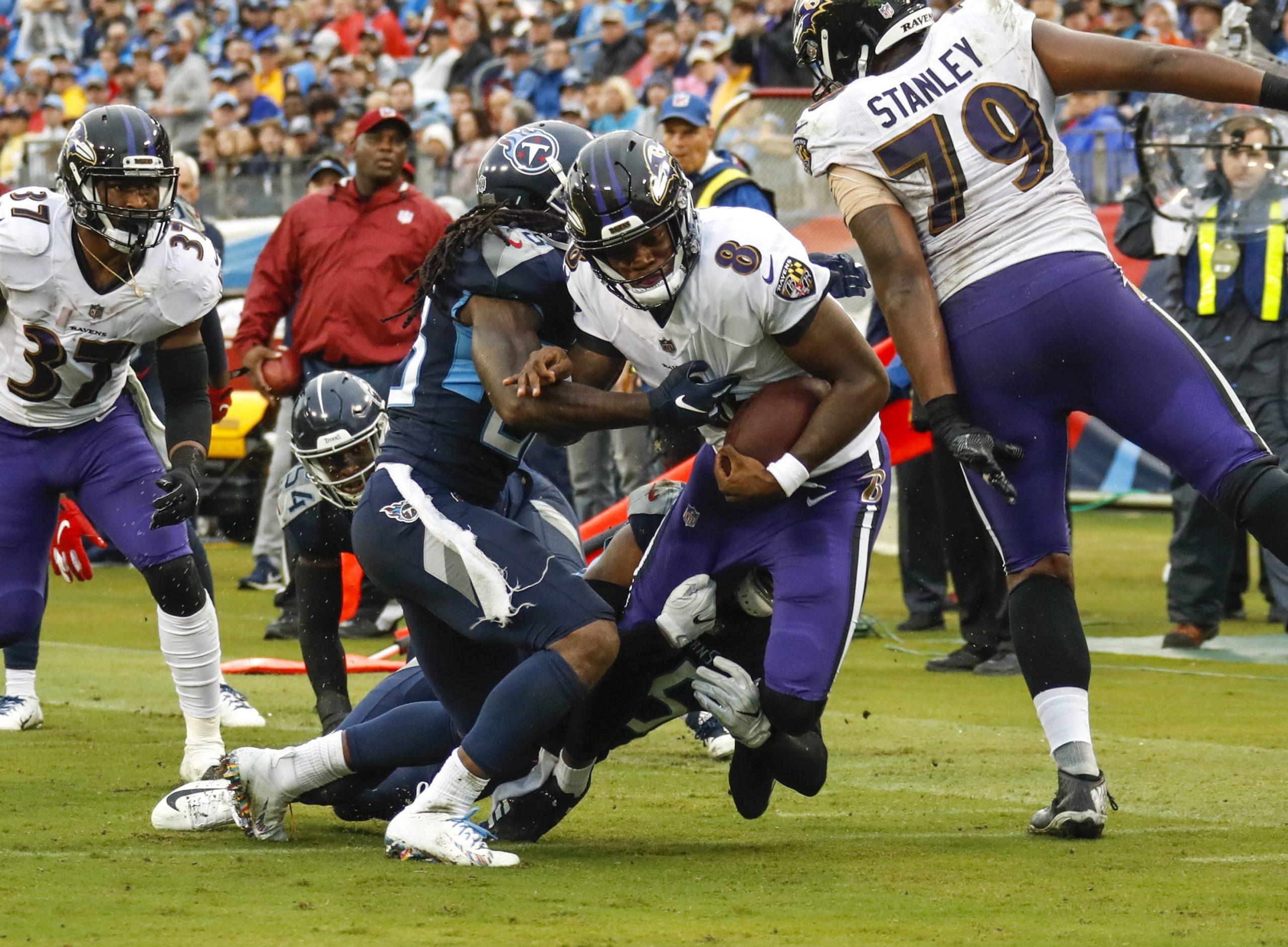 Baltimore Ravens quarterback Lamar Jackson rushing against the Tennessee Titans