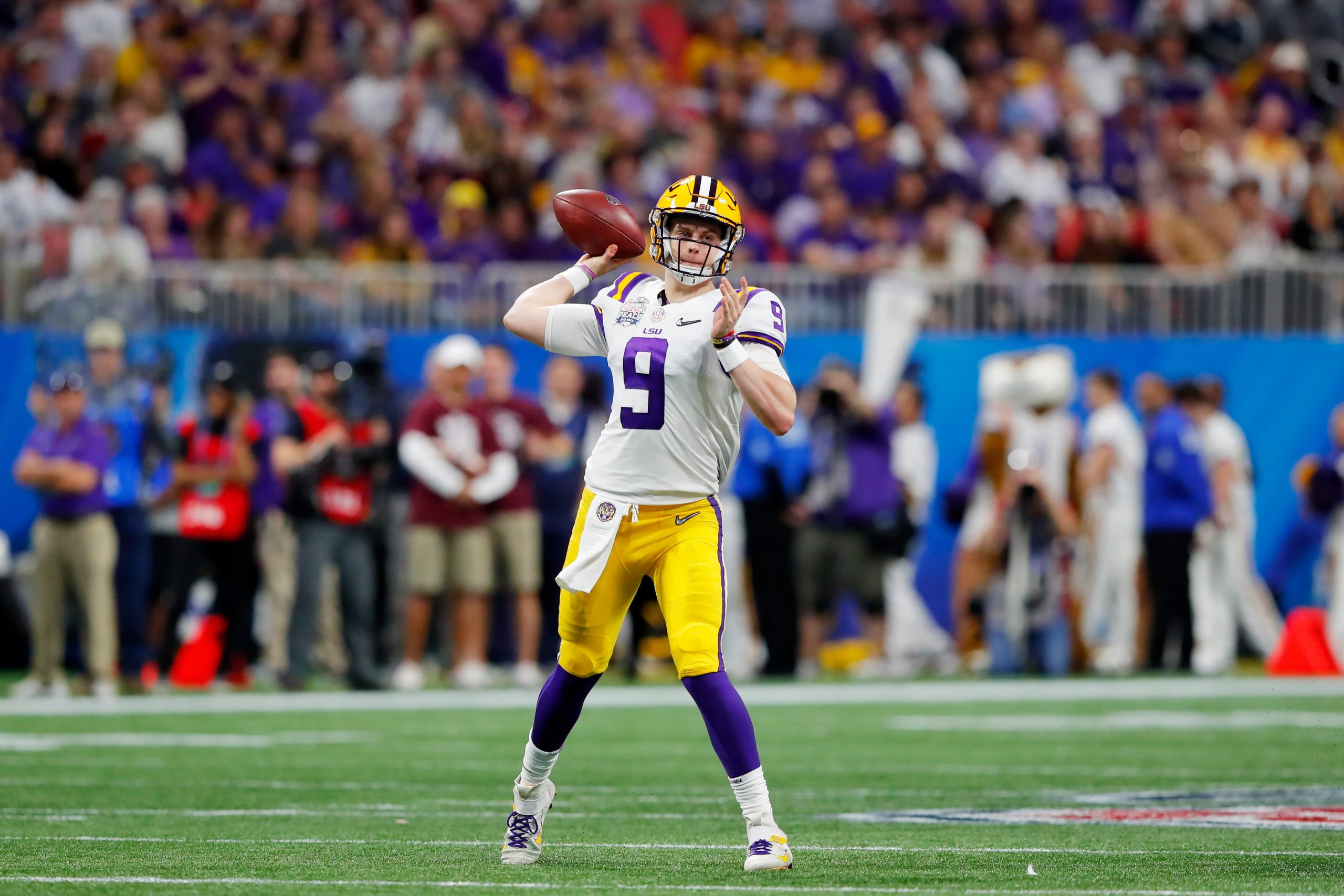 Heisman Trophy winner Joe Burrow throwing a pass during the Peach Bowl
