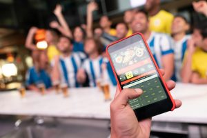 online / mobile sports betting, hand sports betting from phone in bar