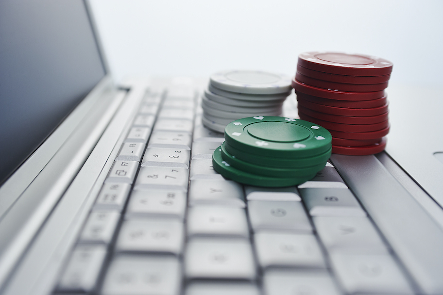 online sports betting and online gambling with poker chips on computer, Massachusetts Sports Betting Bill