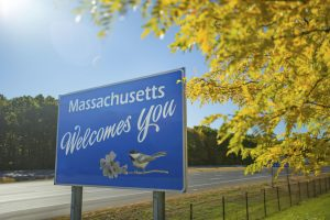 massachusetts welcome sign on road in fall, massachusetts introduces sports betting