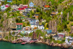 colourful houses on a seasdie hillside in newfoundland, online gambling in newfoundland