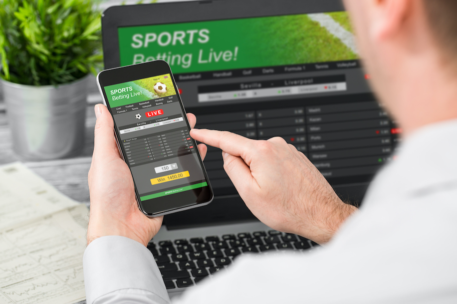Colorado First Legal Online / Mobile Sportsbook, man uses mobile / online sportsbook to bet on sports