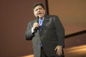 illinois governor j.b. pritzker giving address, governor pritzker signs illinois sports betting bill into place