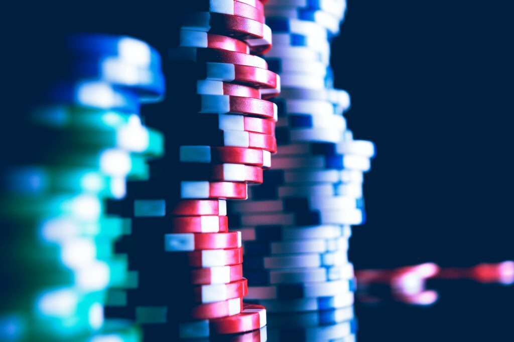 three tall stacks of poker chips - red, white and green