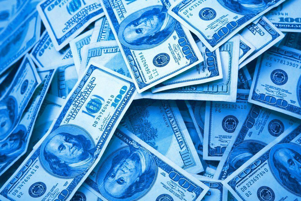 a pile of american $100 bills