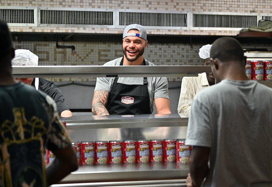 Dak Prescott volunteers at miami homeless shelter donating soup