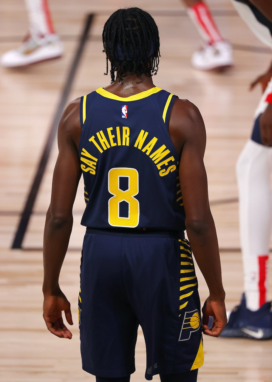 nba social justice jersey message Justin Holiday #8 of the Indiana Pacers equality jersey