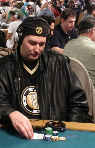 phil hellmuth playing poker and wearing headphones