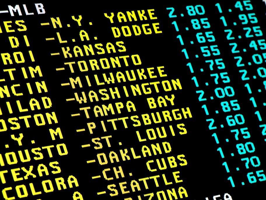 Sports betting board displaying games