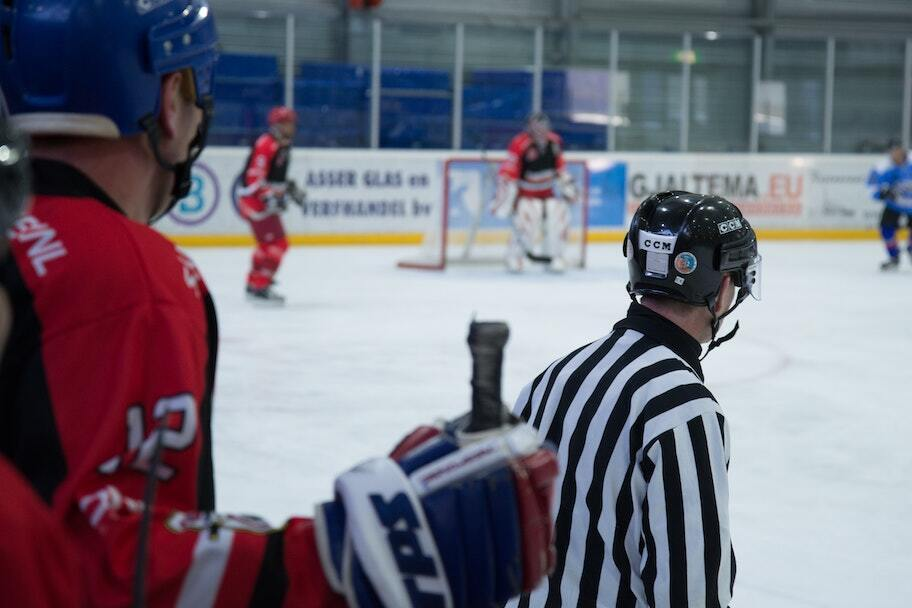 hockey player and referee on ice