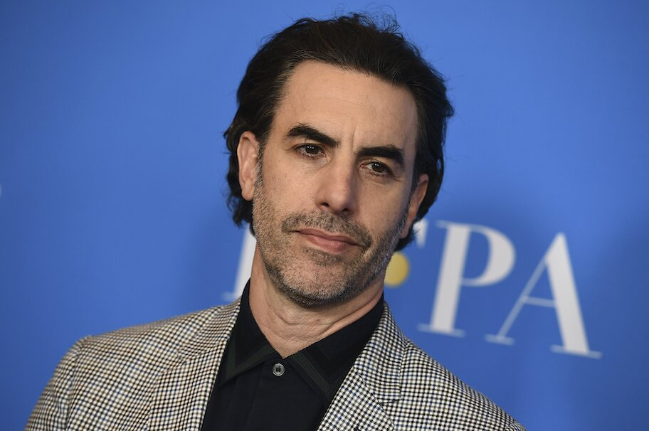 Sacha Baron Cohen with slicked backed hair on red carpet
