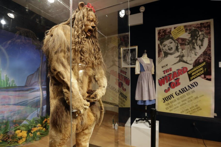 cowardly lion costume on display at museum