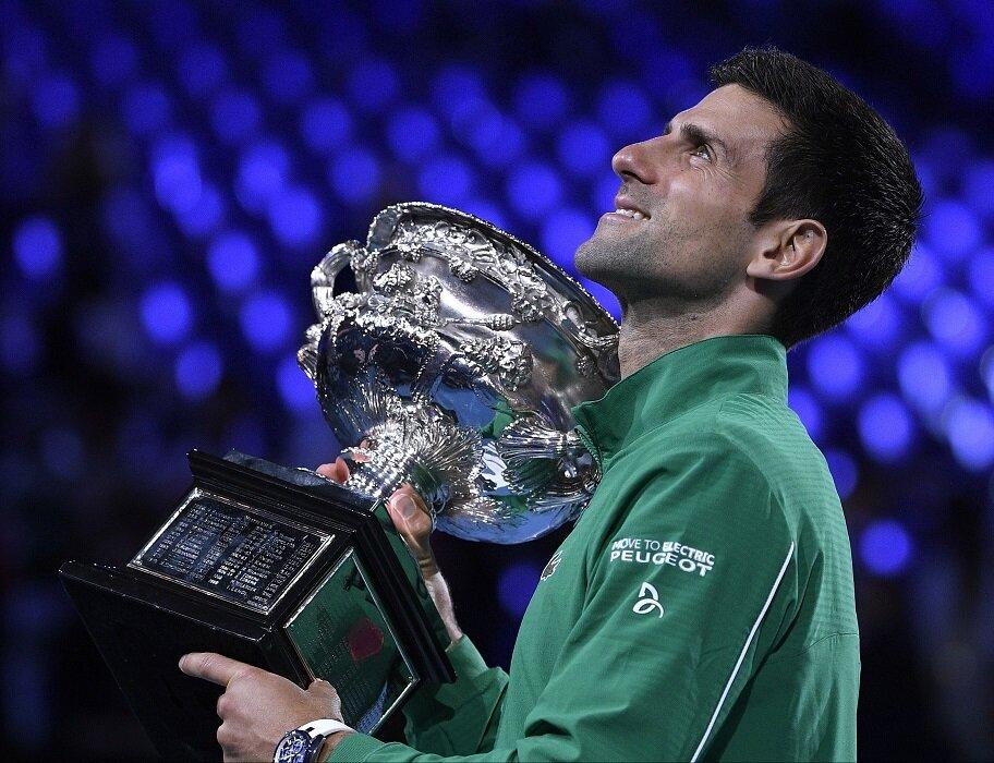 Novak Djokovic holds Australian Open trophy