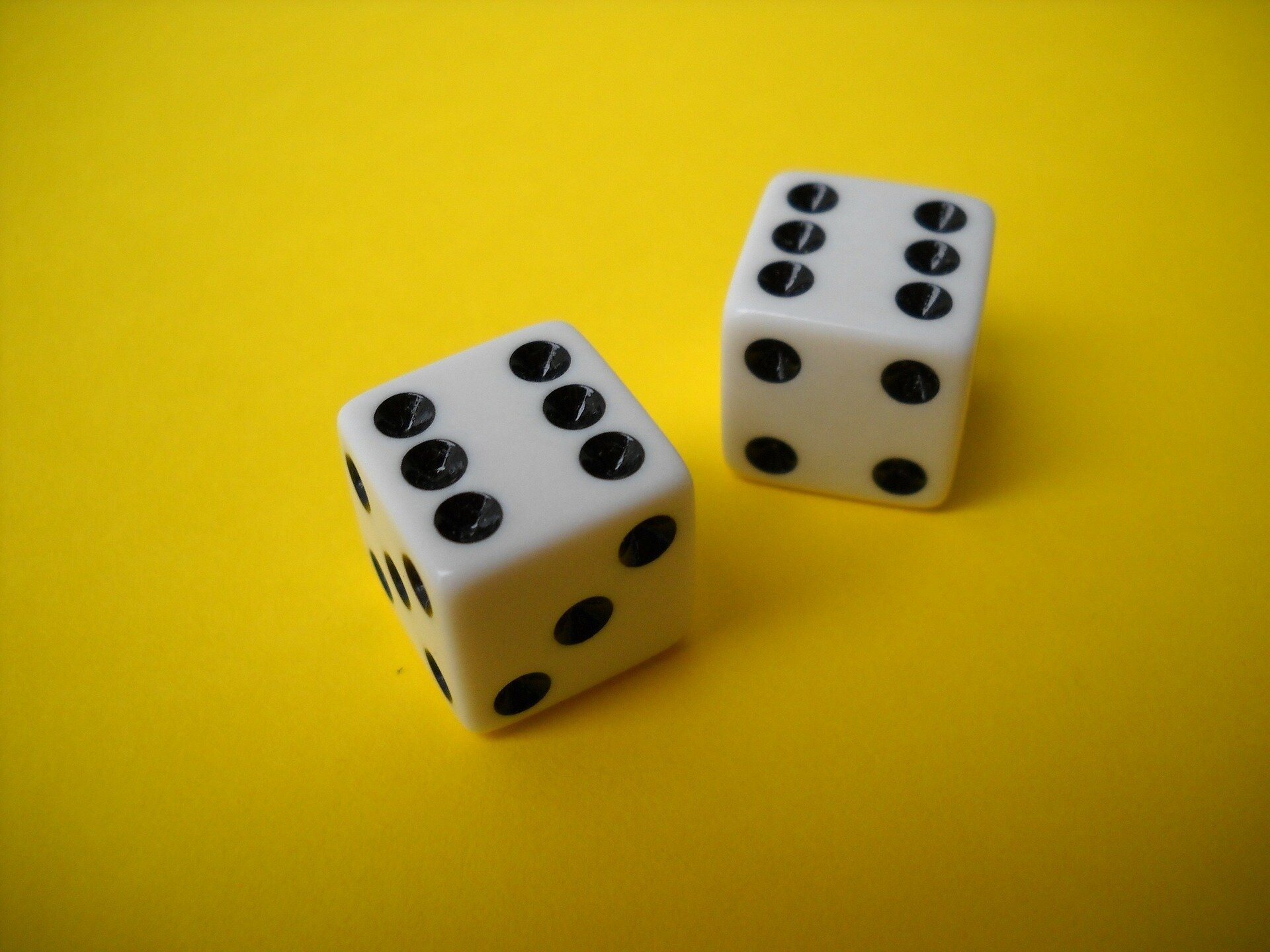 two dice on yellow background