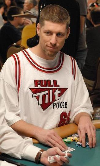 huck seed wears full tilt poker jersey at poker table