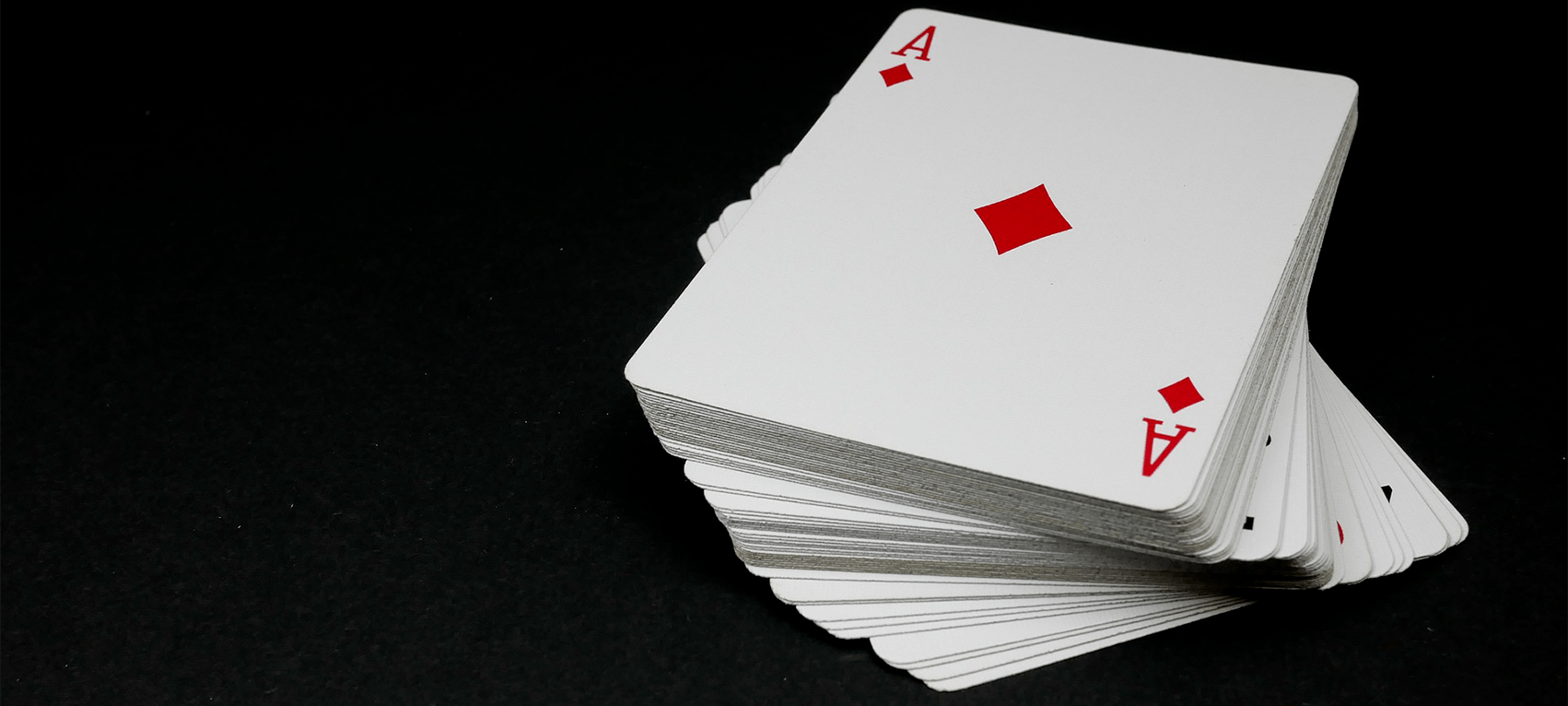 https://www.gambleonline.co/app/uploads/2021/02/pile-of-playing-cards-ace-of-diamonds-on-top-1.png