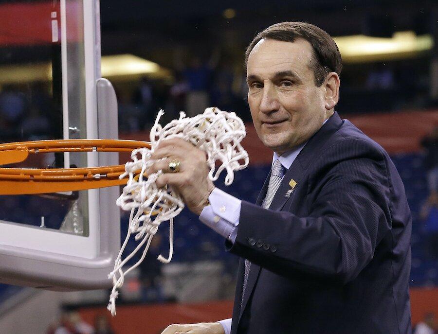 Mike Krzyzewsk duke head coach cuts net down 2015