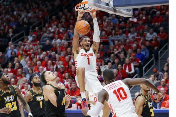 march madness basketball ohio player obio tobin dunks on virginia