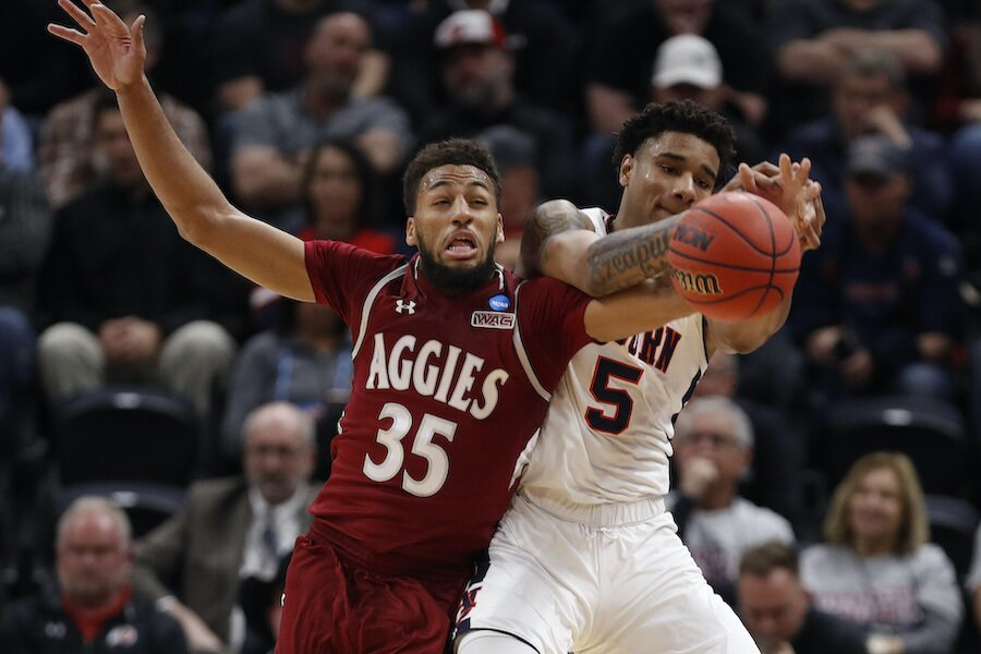 New Mexico State forward Johnny McCants (35) and Auburn forward Chuma Okeke (5) during first round men's basketball game