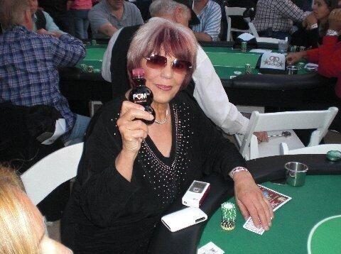 barbara enright playing poker, holding a bottle of juice