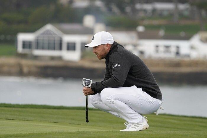 Daniel Berger contemplates a putt