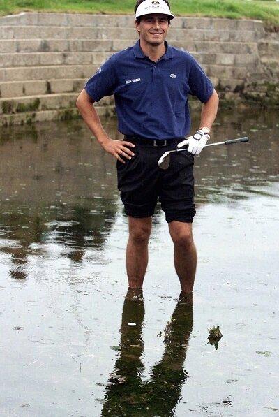 Jean Van De Velde stands in water at Carnoustie