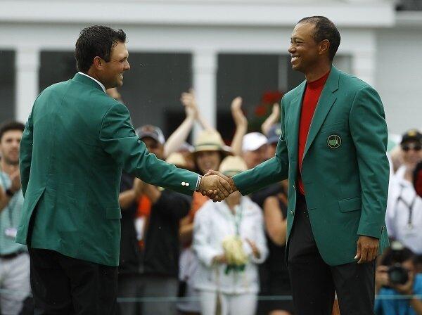Patrick Reed congratulates Tiger Woods