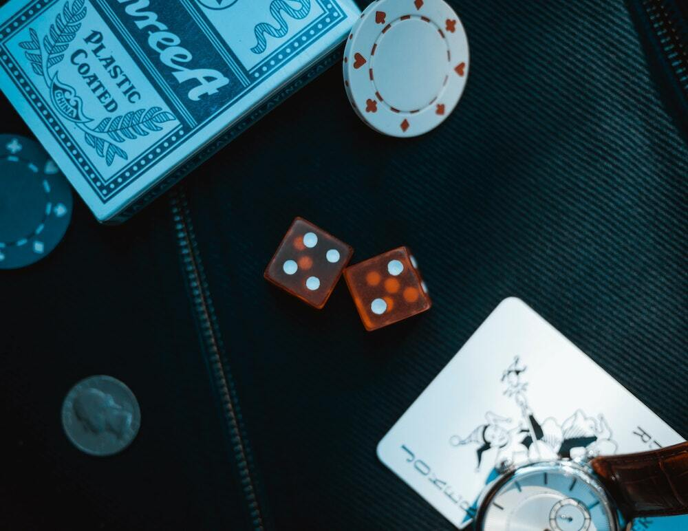 playing cards and dice on casino table