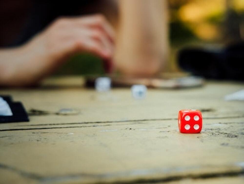 red dice on backgammon table