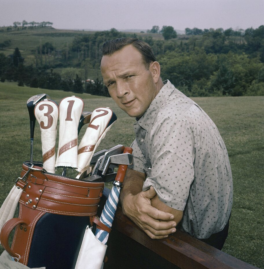 arnold palmer on golf course with clubs