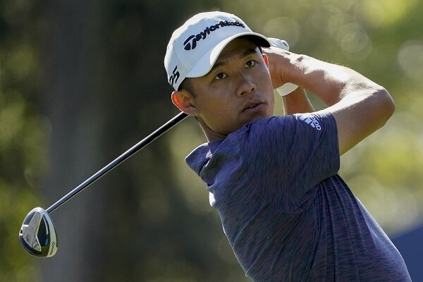 Collin Morikawa watches his golf shot