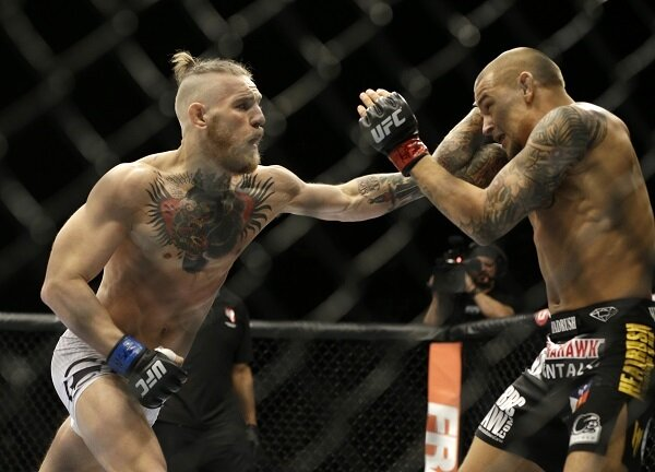Conor McGregor punches Dustin Poirier