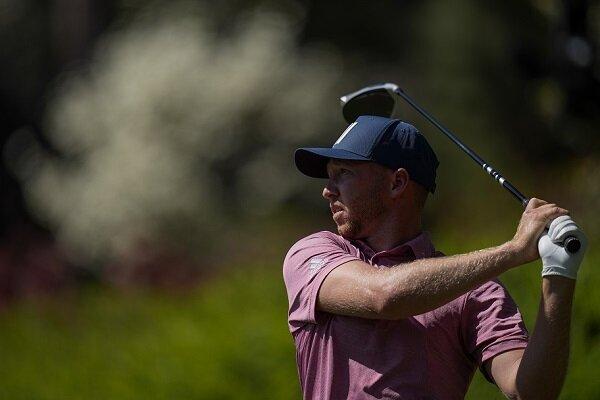 Daniel Berger watches a golf shot