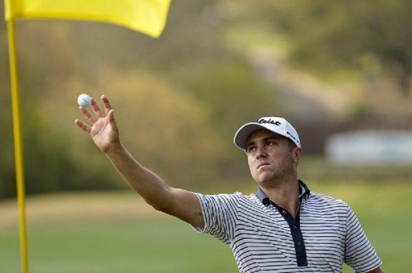 Justin Thomas catches golf ball