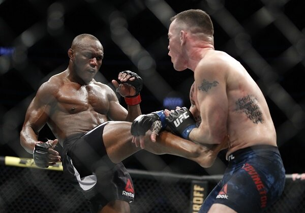 Kamaru Usman kicks Colby Covington